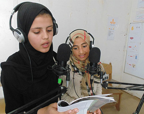 Girls broadcasting from a refugee camp in Jordan